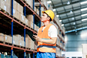 Worker looking through warehouse