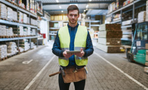 Young man in vest in warehouse